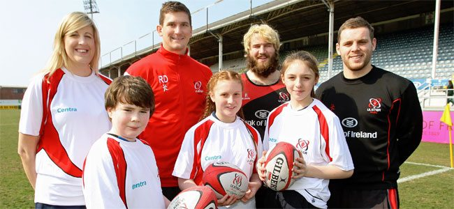 Ulster Rugby players Robbie Diack, Paddy McAllister and Darren Cave are joined by Jenni Barkley from Centra and schoolchildren (L-R) James McEvoy, Aoife Cahill and Eimear Cleary, all Year 8 at Aquinas Diocesan Grammar School, Belfast, to launch the 2013 Centra Ulster Rugby Summer Camps.