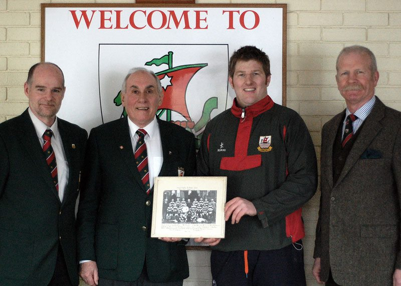 Larne Rugby Club members (l-r) Paul Montgomery, Arthur James, James McCluggage and William Nelson with a picture of the 2013 - 14 Larne towns Cup winning team.