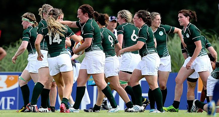 Ailis Egan celebrates with her teammates after scoring Ireland's opening try in the 2014 Women's Rugby World Cup.