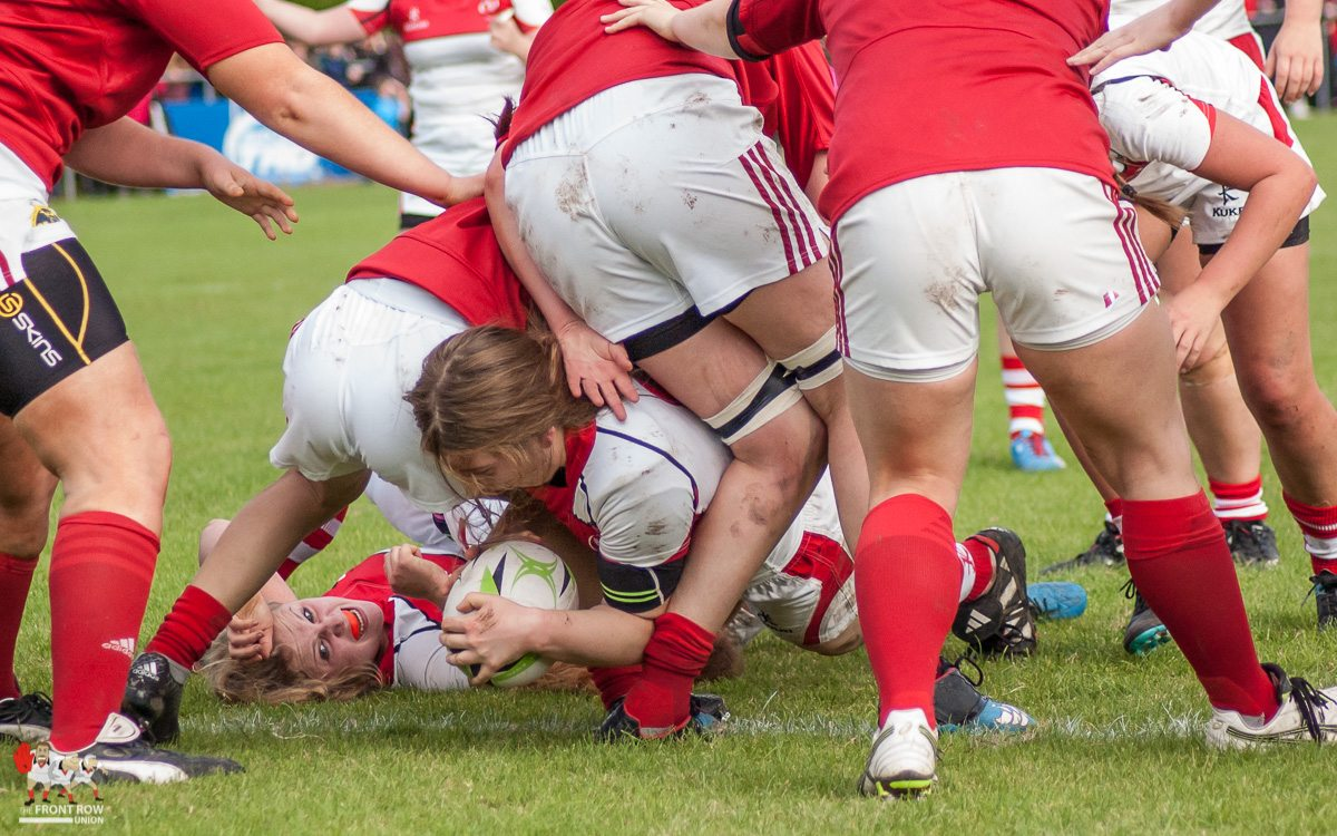 Claire Boles battles through the Munster defence to score for Ulster U18's.