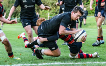 CCBs Tom Robinson goes over for the opening try against Ballymena Academy.